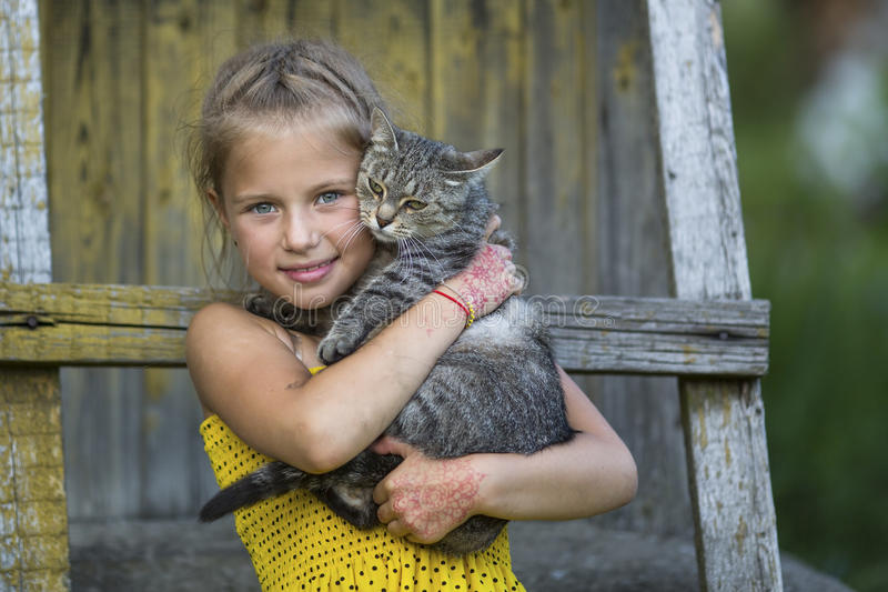 Little girl playing with a cat. Nature. Little girl playing with a cat stock images