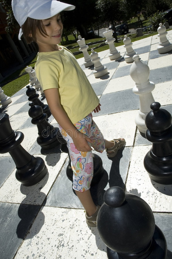 Download Little girl playing chess stock photo. Image of game, outdoor - 6459106