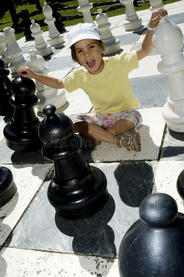 Download Little girl playing chess stock image. Image of pretty - 6459195