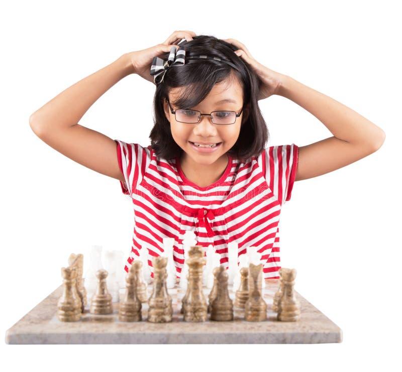 Little Girl Playing Chess III royalty free stock photo