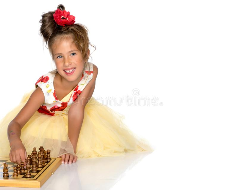 Little girl playing chess royalty free stock photos