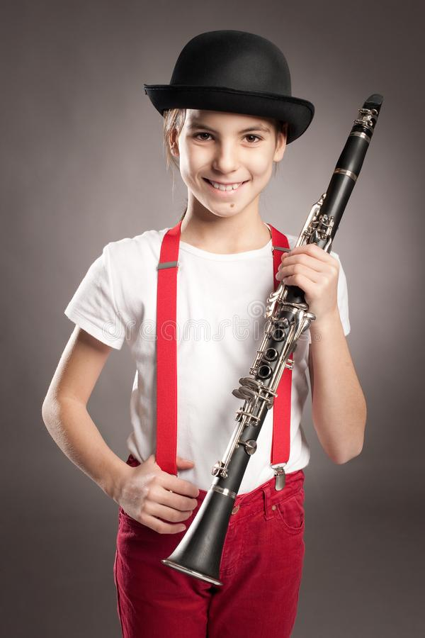 Little girl playing clarinet royalty free stock photos