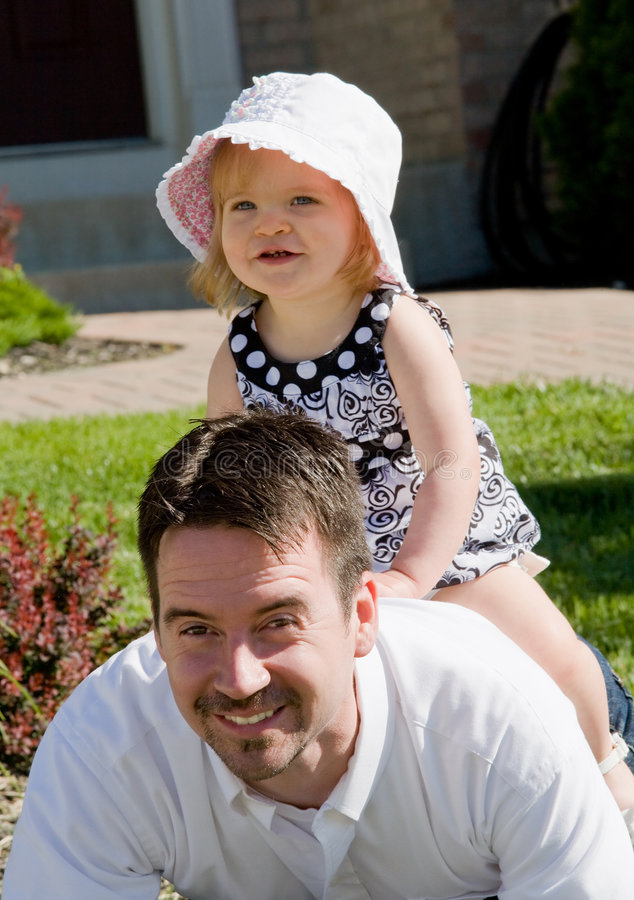 Little Girl Playing with Dad royalty free stock image