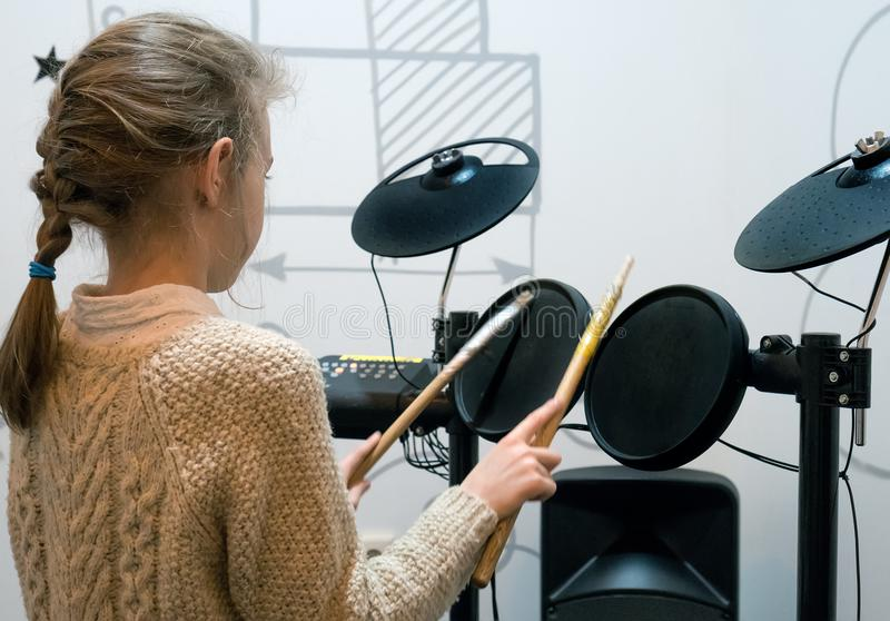 Little girl playing drums. royalty free stock images