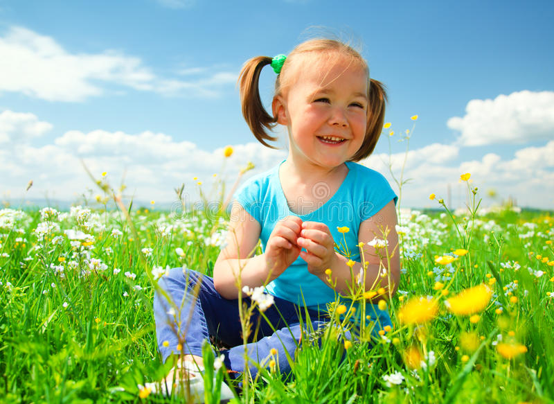 Download Little Girl Is Playing On Green Meadow Royalty Free Stock Photography - Image: 19587497