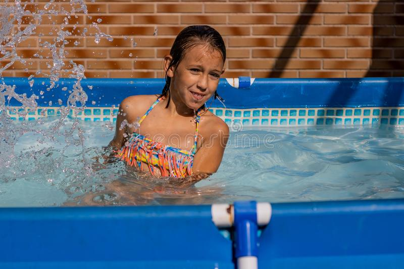 Little girl in the pool royalty free stock photo