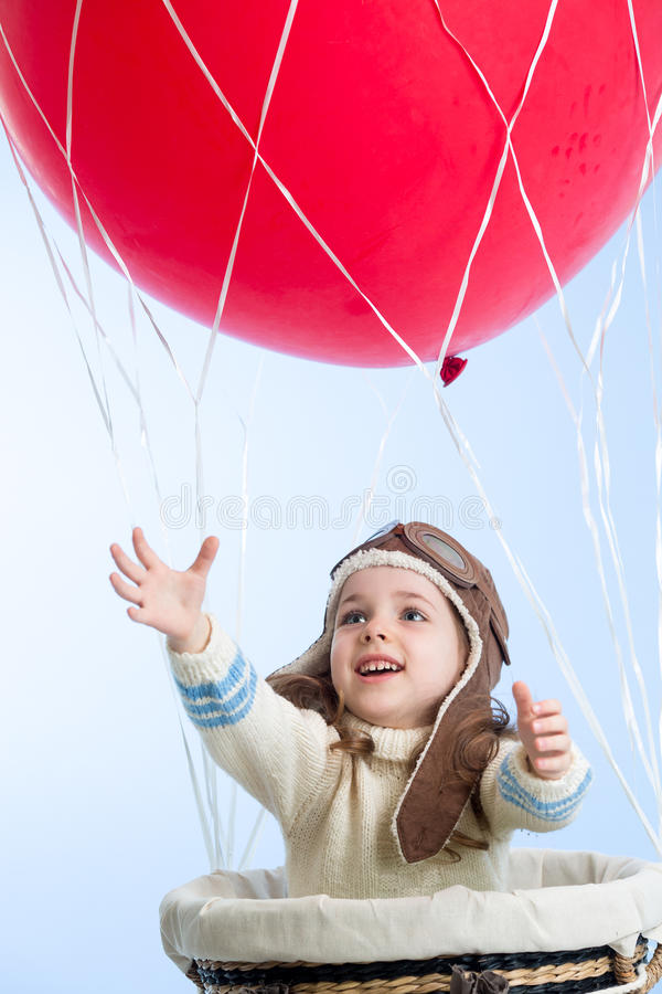 Little girl playing on hot air balloon in the sky royalty free stock photo