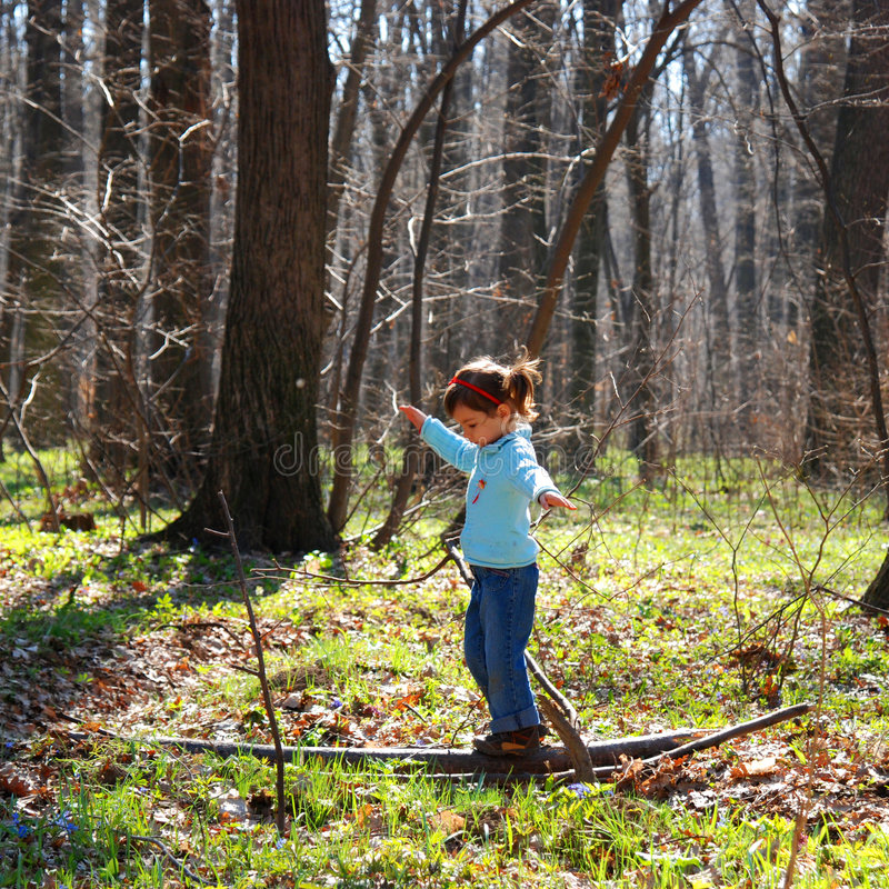 Free Little Girl Playing In Woods Stock Image - 4888731