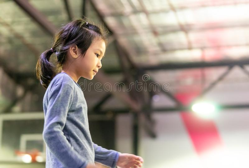 Little girl playing in indoor sport gym. Little girl is playing in indoor sport gym royalty free stock photo