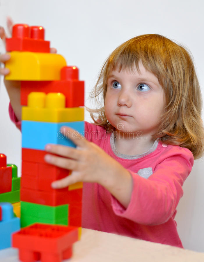 Download A Little Girl Playing With Lego Blocks Stock Image - Image of game,  colorful