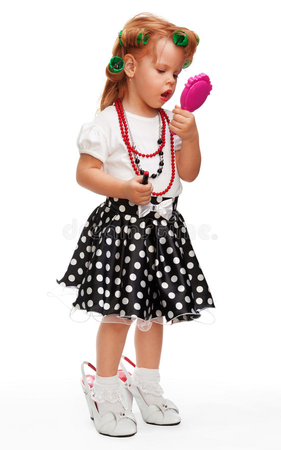 Little girl playing with makeup stock photos