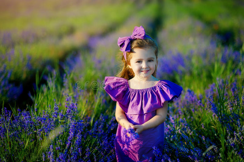 Little girl playing in nature at sunset. Selective focus and small depth of field. stock image