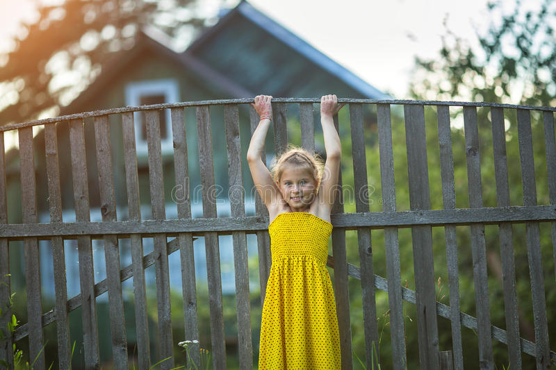 Little girl playing near village houses. royalty free stock photos