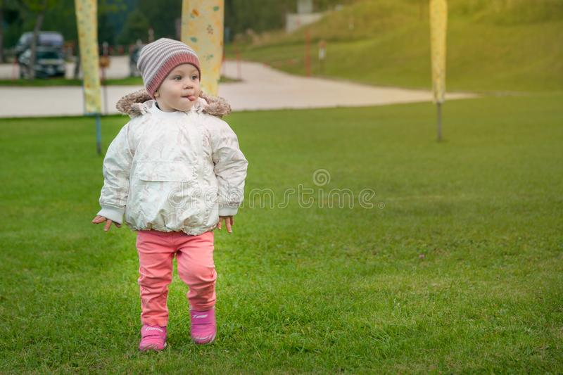 Little girl playing outdoors. Little baby girl playing outside in a late summer day stock photos