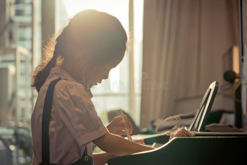 Little girl playing with piano and Music Tablet at home stock images
