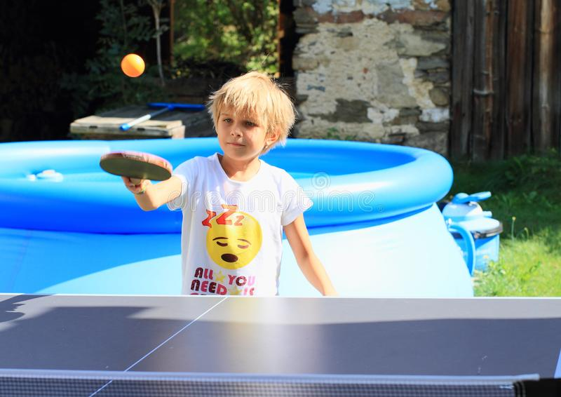 Little girl playing ping-pong royalty free stock images