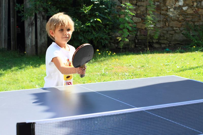 Little girl playing ping-pong stock photo