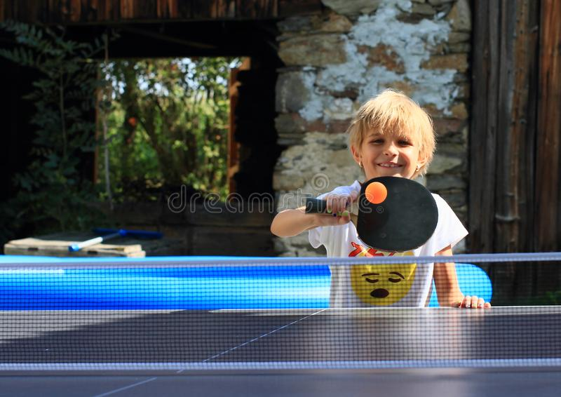 Little girl playing ping-pong stock image