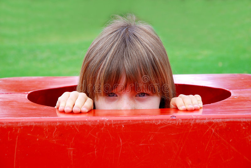 Little girl playing on playground royalty free stock photography