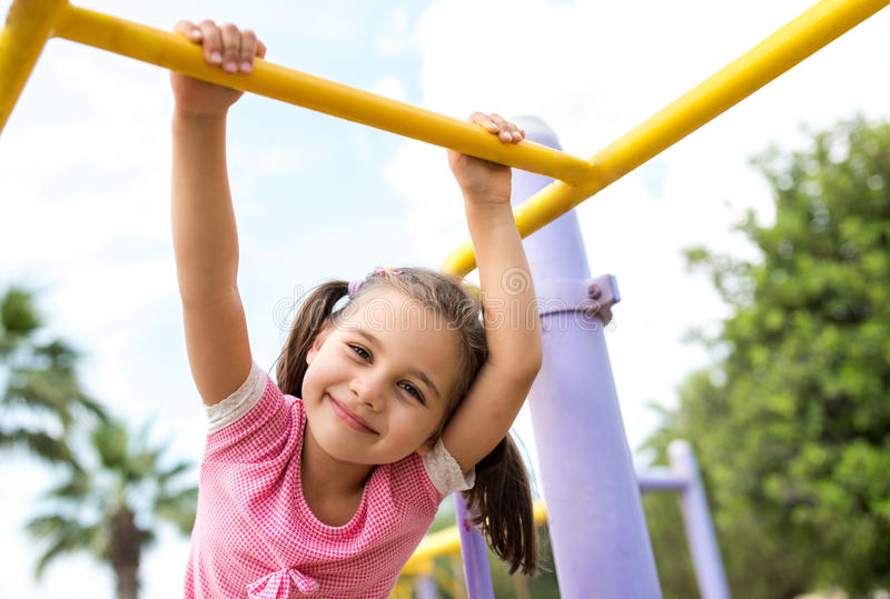 Little Girl Playing At Playground Outdoors stock photos
