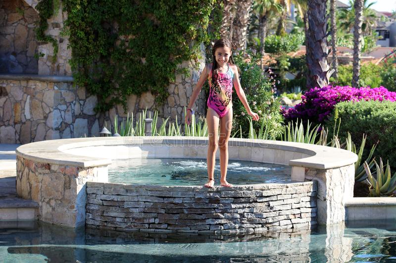 Little girl playing at the pool in Mexican villa. Pool party 50 megapixels photo stock photography