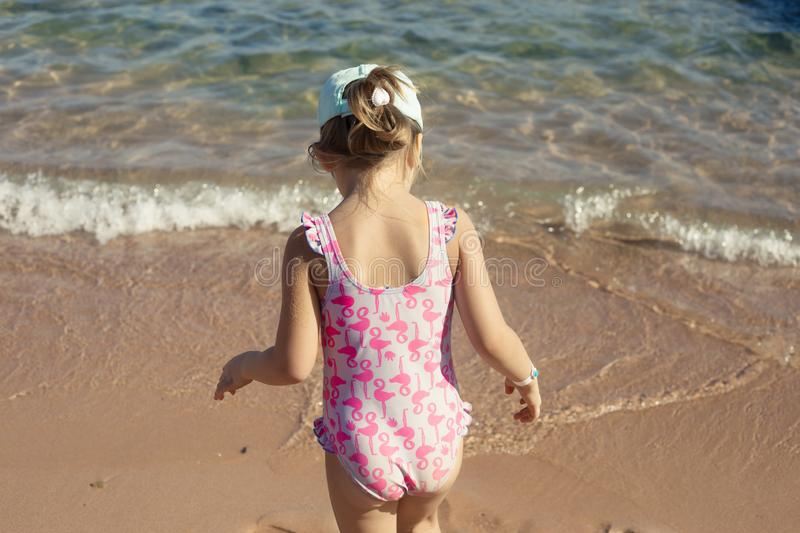 Little girl are playing on sea beach summer vacation stock images