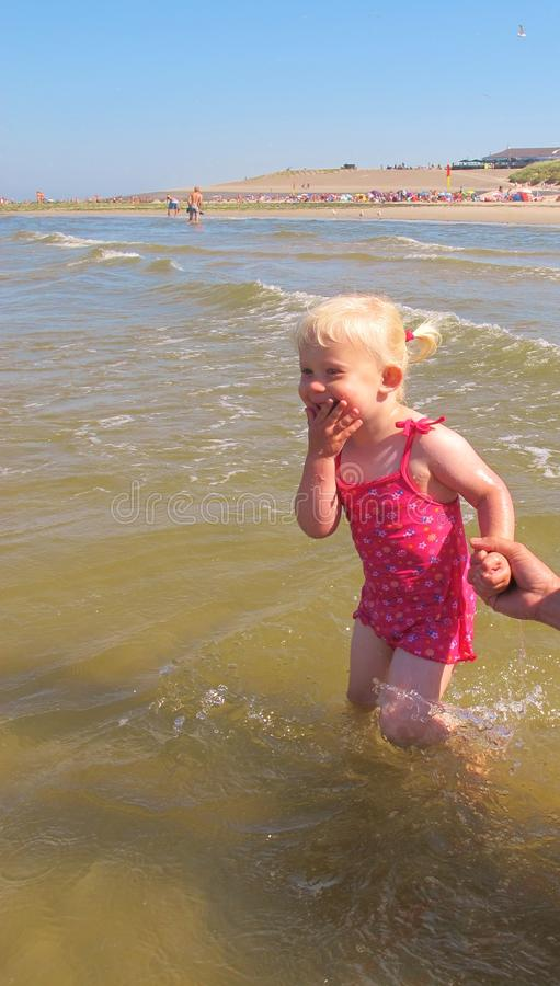 Little girl playing in sea royalty free stock images