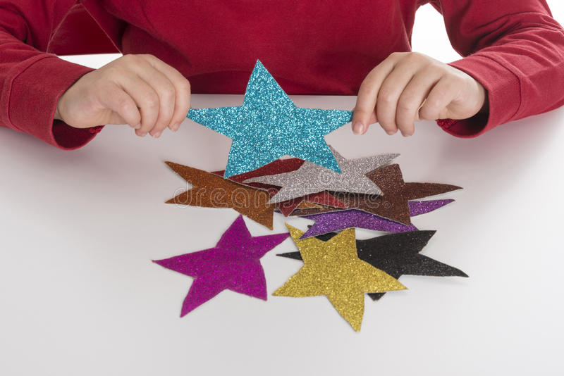 Little girl playing with stars stock image