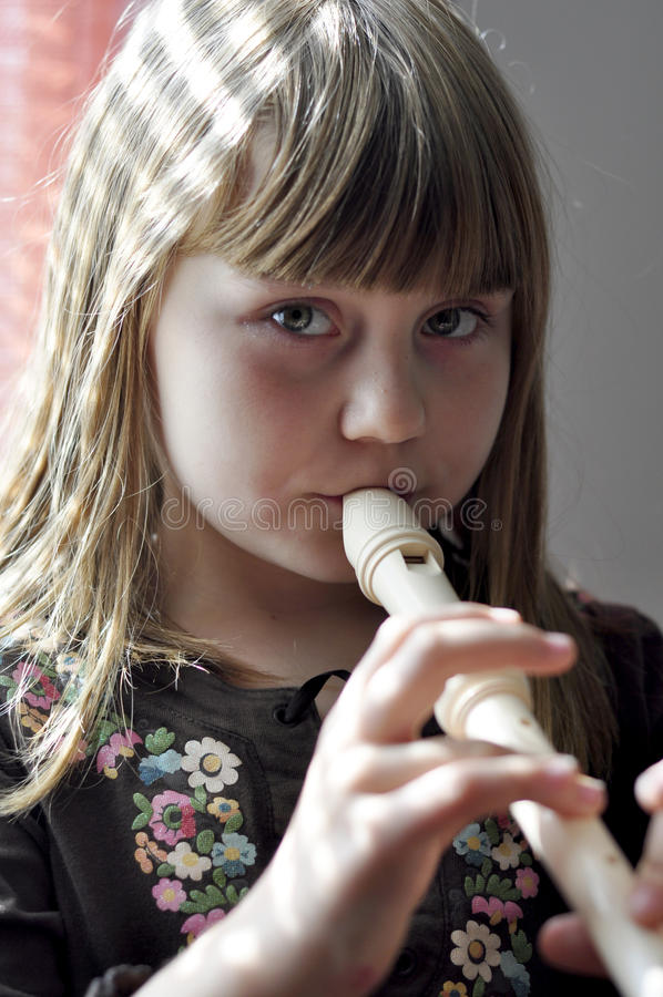 Free Little Girl Playing The Flute Royalty Free Stock Images - 16113419