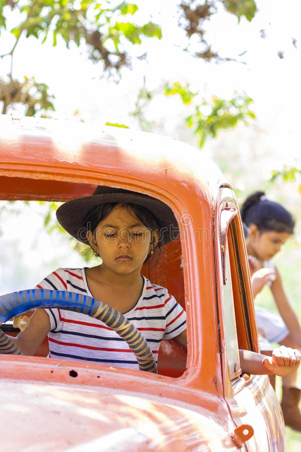 Little girl playing to drive cargo truck stock photography