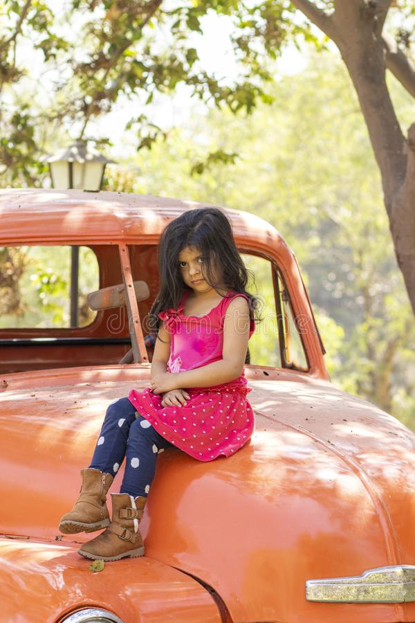 Little girl playing to drive cargo truck stock photo