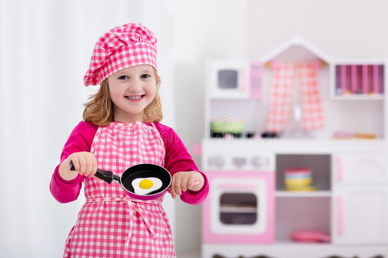 Download Little Girl Playing With Toy Kitchen Stock Image   Image Of Kids,  Apron: