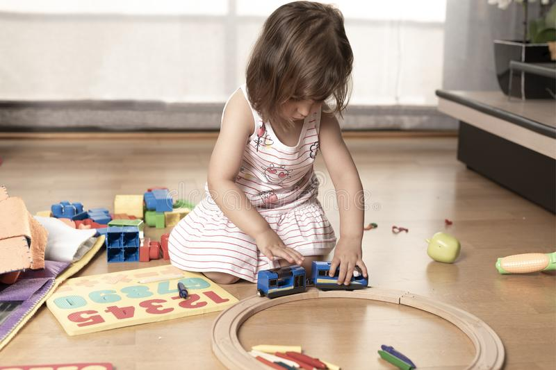 Little Girl Playing With Train Toys royalty free stock images