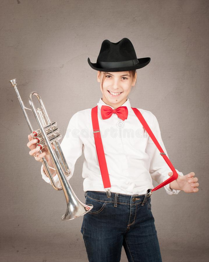 Little girl playing trumpet royalty free stock photos