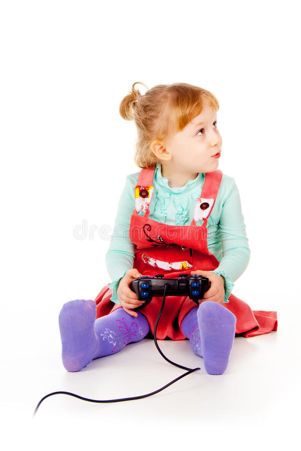 Little Girl Playing Video Games On The Joystick Stock Image