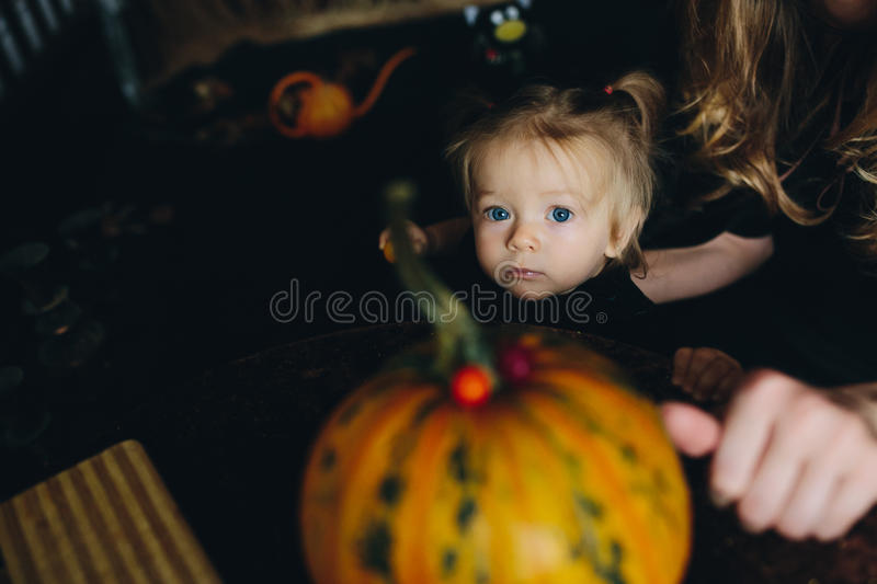 Little girl playing in a witch royalty free stock photo