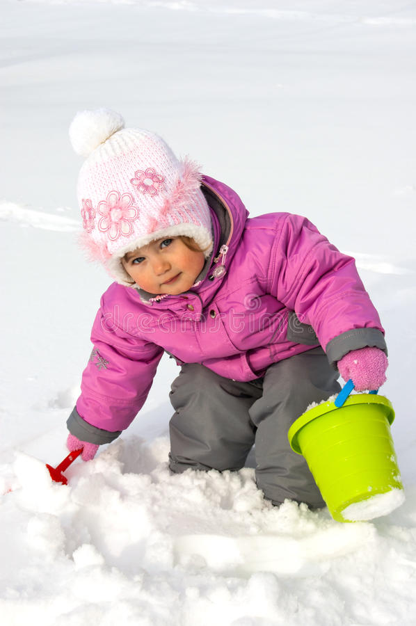 Free Little Girl Playing With Snow Royalty Free Stock Image - 27234896