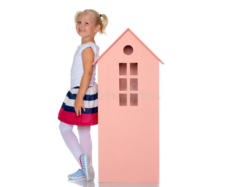 Little girl is playing with wooden houses. royalty free stock images
