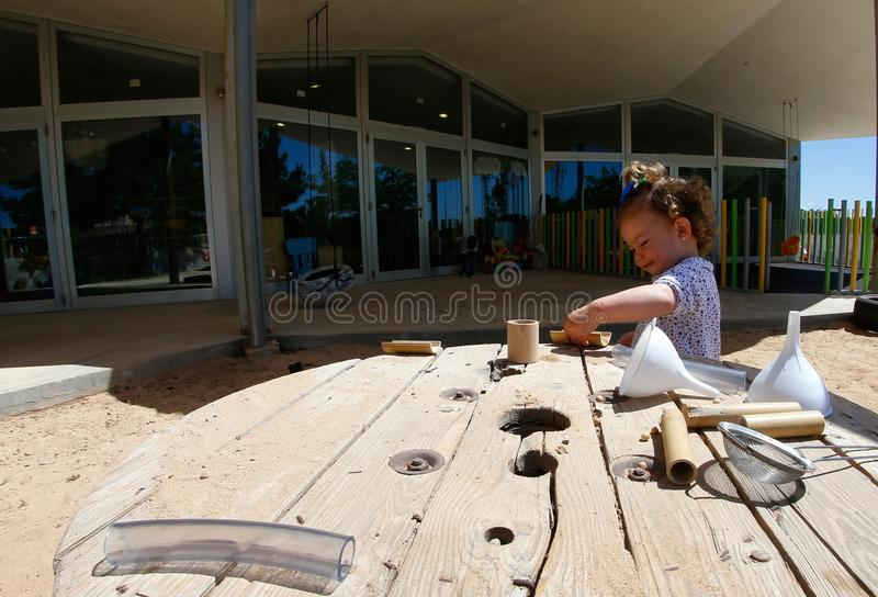 Little girl playing during break time at Kindergarten in Mallorca royalty free stock photos