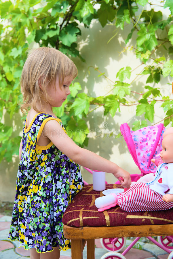 A Little Girl Plays With Dolls Royalty Free Stock Images