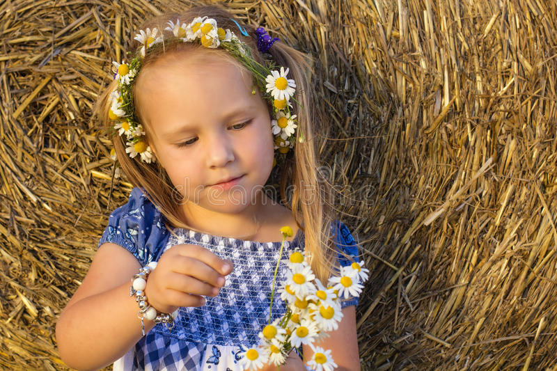 A little girl plays he loves me, he loves me not stock images