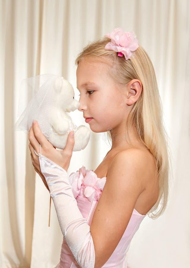 Little Girl Plays With Wedding Teddy Bear Stock Photo