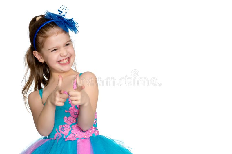 Little girl points with a finger royalty free stock photo