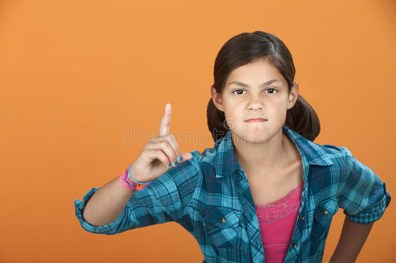 Little Girl Poiting Index Finger royalty free stock photos