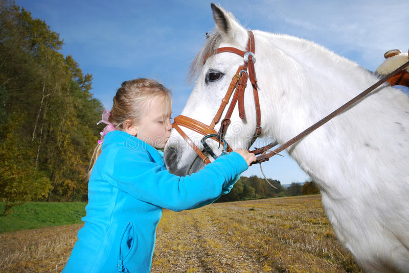 Little girl with pony stock photography