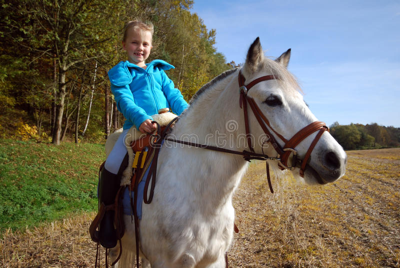 Little girl with pony stock photos