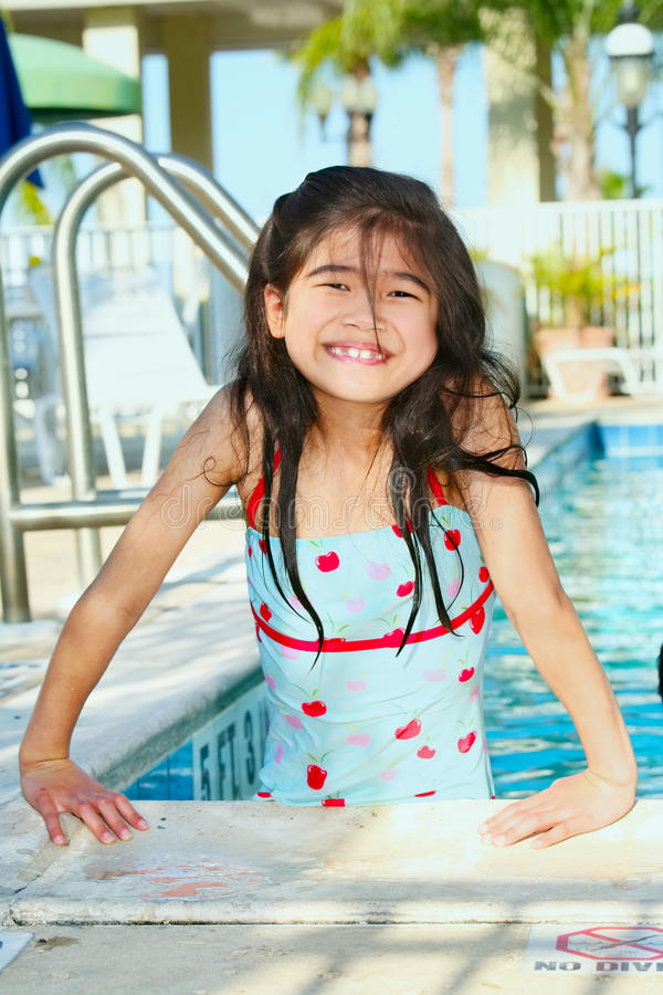 Little girl at the pool royalty free stock photo