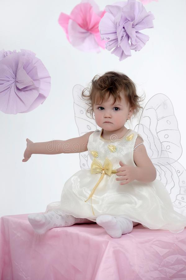 Little girl portrait sitting with butterfly wings stock images