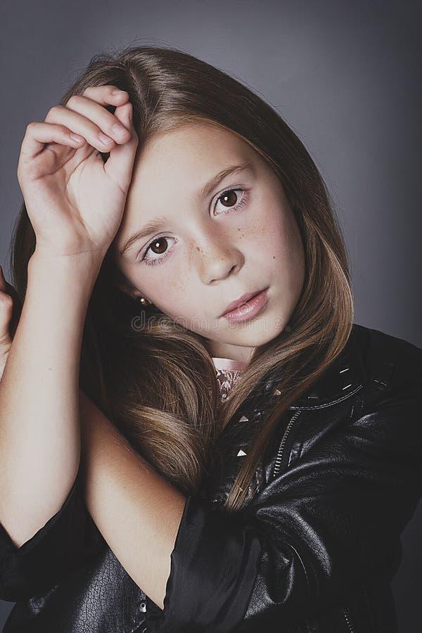 Little girl posing like a fashion model. Young little girl posing like a fashion model stock photos