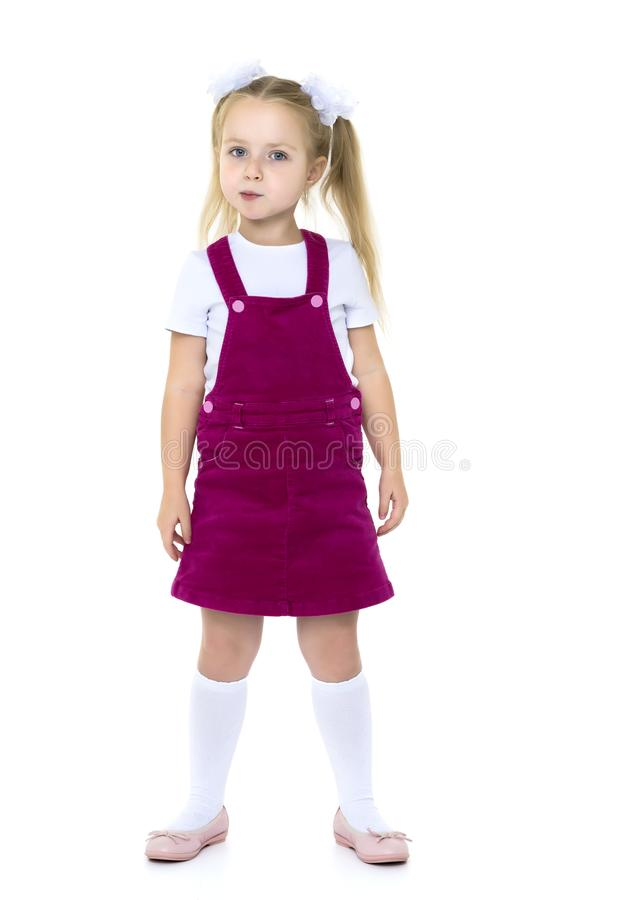 Little girl posing in studio on a white background. stock photography